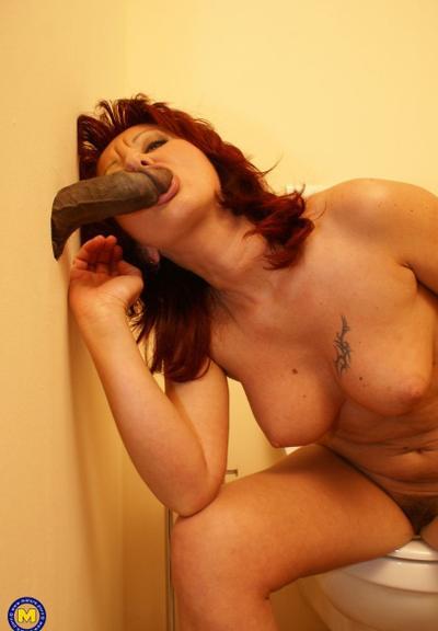 Photo №5 Redhead mature mom Monika fucks big black dick at gloryhole in the toilet