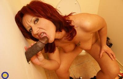 Photo №6 Redhead mature mom Monika fucks big black dick at gloryhole in the toilet