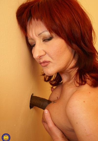 Photo №9 Redhead mature mom Monika fucks big black dick at gloryhole in the toilet