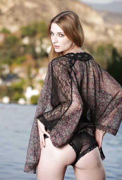 Photo №10 Beautiful blonde model Ela Darling is stripping outdoors