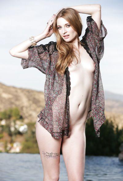 Photo №13 Beautiful blonde model Ela Darling is stripping outdoors