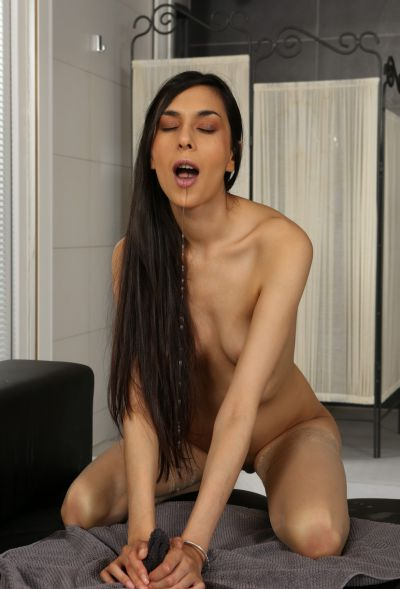 Photo №9 Skinny brunette Ashley Ocean squirts and toys her wet pussy