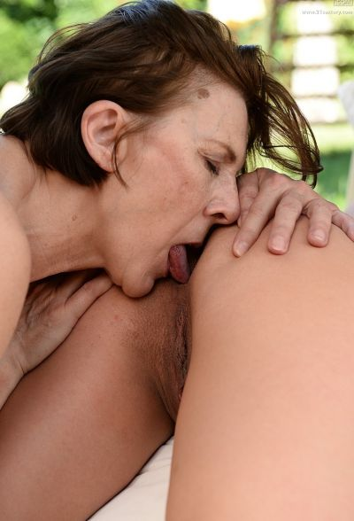 Photo №14 Old brunette has lesbian sex with a young brunette
