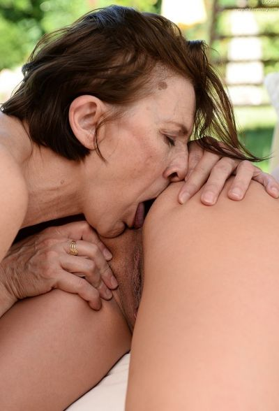 Photo №15 Old brunette has lesbian sex with a young brunette