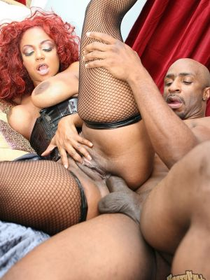 Curly redhead ebony MILF Sinnamon Love has anal sex in stockings