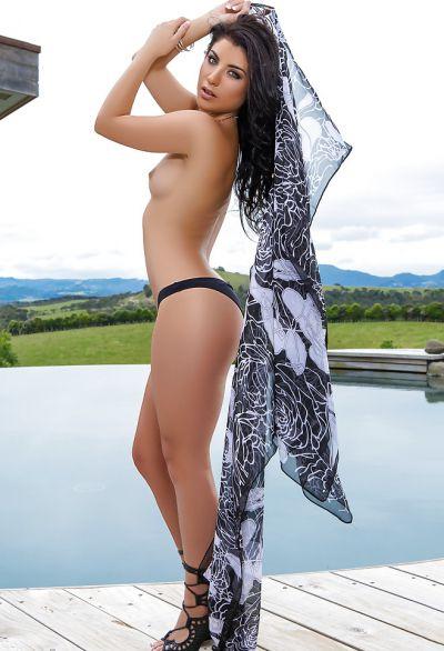 Photo №3 Beautiful wet brunette girl Elle Georgia by pool
