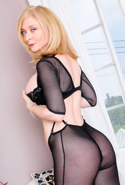 Photo №1 Mature blonde Nina Hartley in pantyhose & boots displays pussy