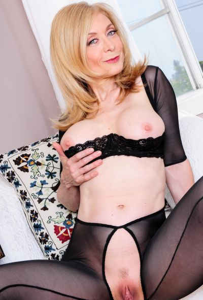 Photo №15 Mature blonde Nina Hartley in pantyhose & boots displays pussy