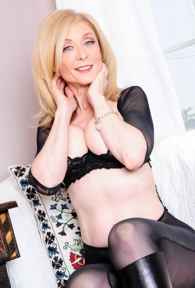 Photo №4 Mature blonde Nina Hartley in pantyhose & boots displays pussy