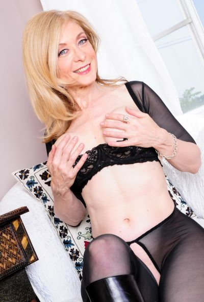 Photo №7 Mature blonde Nina Hartley in pantyhose & boots displays pussy
