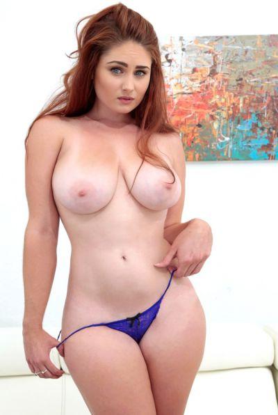 Photo №3 Redhead cutie takes cum on her big breasts